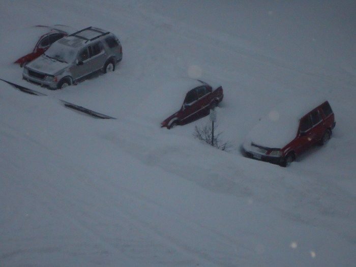 Cars deep in snow..
